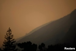 Thick smoke from wildfires hangs over Big Sur, California, Dec. 16, 2013
