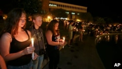 Students and supporters take part in a candle light vigil at the University of Central Florida to honor Steven Sotloff a journalist who was beheaded by the Islamic State group.