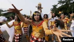 Balinese Hindu dancers perform during a ritual before Nyepi Day in Jakarta, Indonesia, March 20, 2015.