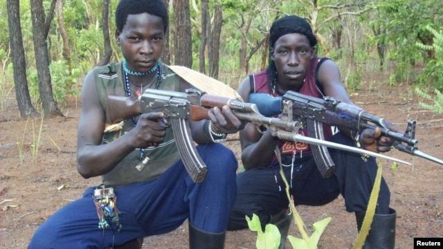 Fighters loyal to the Lord's Resistance Army (LRA) with their rifles inside the forest near River Mbou in the Central African Republic in this handout picture dated April 4, 2012