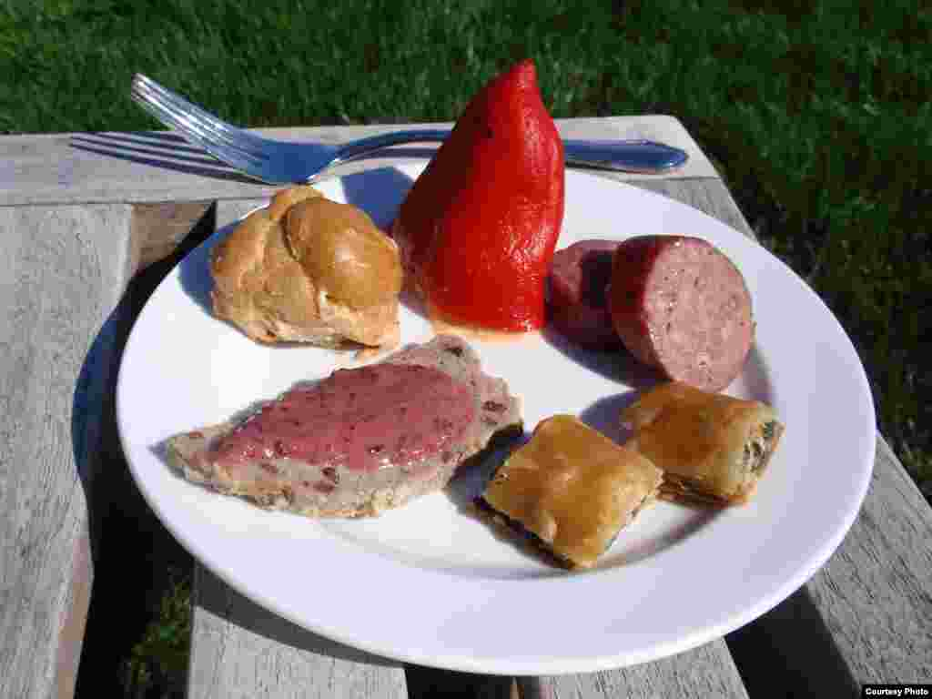 Crayfish-stuffed piquillo pepper, sorrel smoked salmon puff, wild turkey terrine with blackberry mustard, dandlion spanakopita and wild boar bratwurst. (Tom Banse)