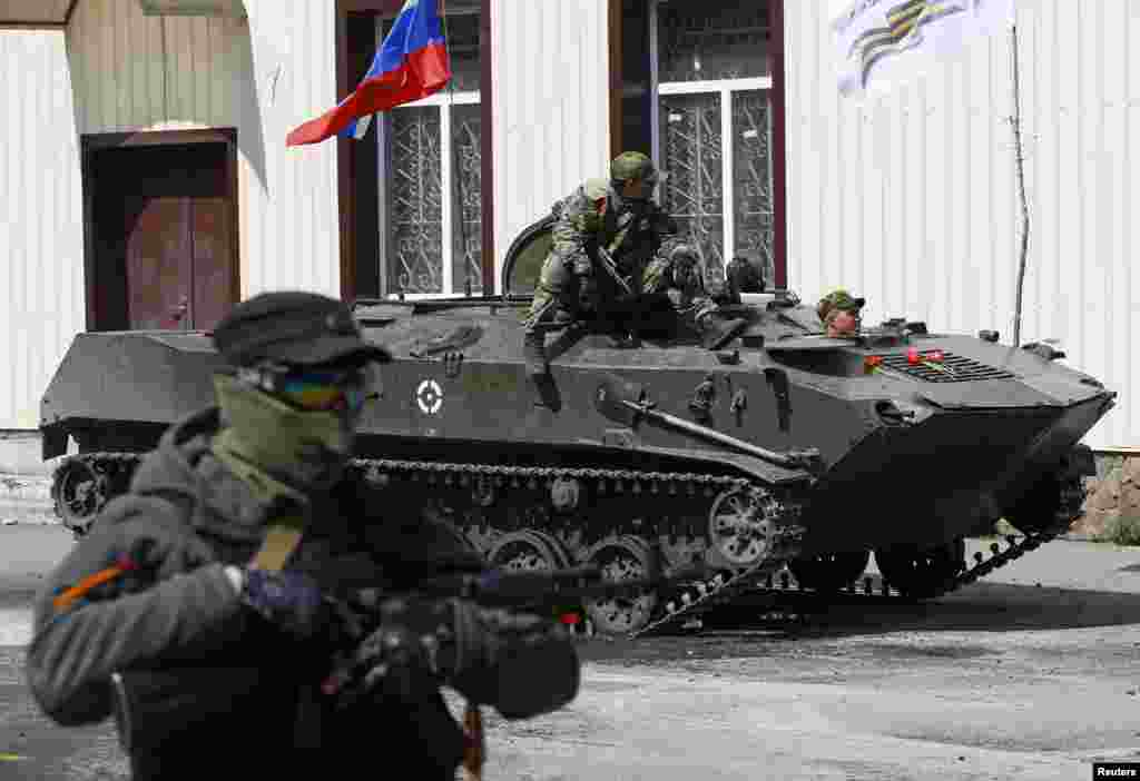 A Russian flag is seen on top of an armoured personnel carrier in Slaviansk Ukraine.