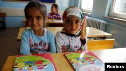 FILE - Syrian refugee children are seen in their classroom at Fatih Sultan Mehmet School in the Karapurcek district of Ankara, Turkey, Sept. 28, 2015.