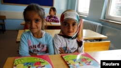 FILE - Syrian refugee children study at Fatih Sultan Mehmet School in Ankara, Turkey, Sept. 28, 2015. A new UNICEF appeal aims to assist youngsters, including in getting education.