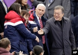 U.S. Vice President Mike Pence and South Korean President Moon Jae-in attend the women's 500-meter short-track speedskating event in the Gangneung Ice Arena at the 2018 Winter Olympics in Gangneung, South Korea, Feb. 10, 2018.