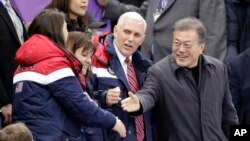 United States' Vice President Mike Pence and South Korean President Moon Jae-in attend the ladies' 500 meters short-track speedskating in the Gangneung Ice Arena at the 2018 Winter Olympics in Gangneung, South Korea, Feb. 10, 2018.