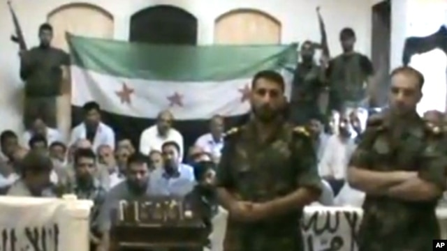 This image made from a video released by the Baraa Brigades and accessed Sunday, Aug. 5, 2012, purports to show Free Syrian Army soldiers guarding a group of Iranians abducted a day earlier.