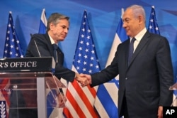 FILE - Israeli Prime Minister Benjamin Netanyahu, right, and U.S. Secretary of State Anthony Blinken shake hands during a press conference in Jerusalem, May 25, 2021.