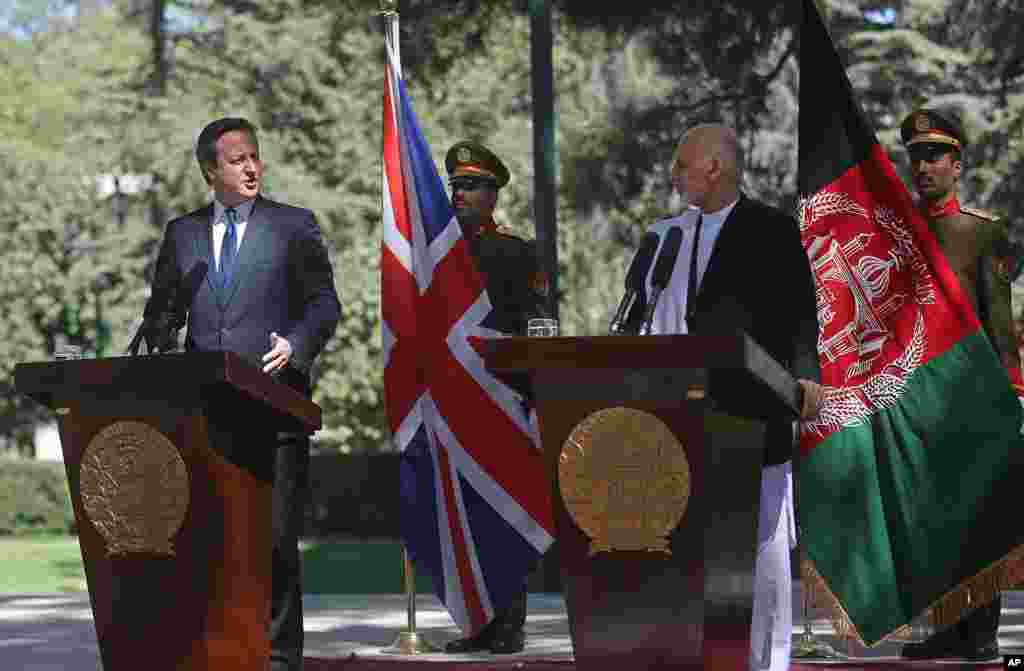 Afghanistan's president Ashraf Ghani Ahmadzai, right, listens as Britain's Prime Minister David Cameron talks during a news conference at the presidential palace in Kabul, Afghanistan, Friday, Oct. 3, 2014.
