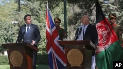 David Cameron (à g.) et le président afghan, Ashraf Ghani Ahmadzai