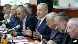 Israel's Prime Minister Benjamin Netanyahu, center, speaks during the weekly cabinet meeting in Jerusalem, Jan. 31, 2016.