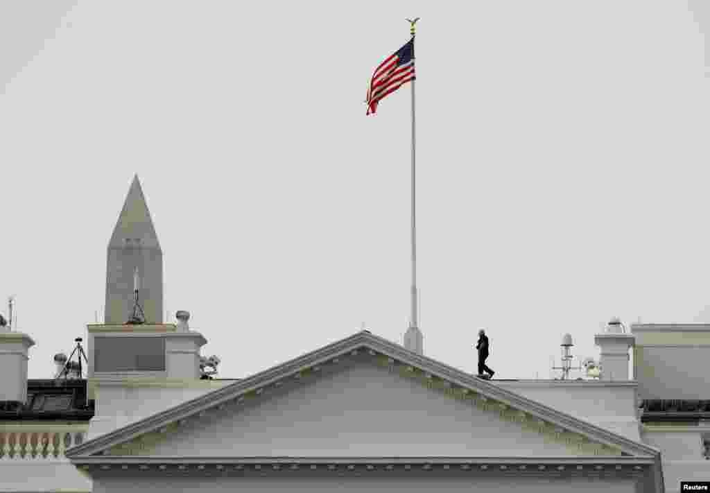 The U.S. flag flies at full staff over the White House in Washington less than 48 hours after Senator John McCain's death.