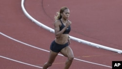 United States runner Sanya Richards-Ross trains for the 2012 Summer Olympics, July 23, 2012, in Birmingham, England.
