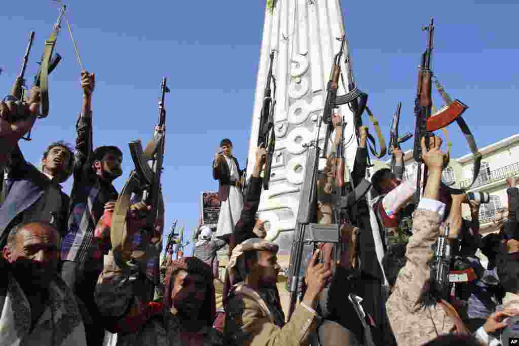 Shiite rebels, known as Houthis, hold their weapons in the air during a demonstration against an arms embargo imposed by the U.N. Security Council on Houthi leaders, in Sana'a, April 16, 2015.