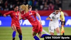 Mexico defender Jimena Lopez (5) passes the ball while U.S. midfielder Samantha Mewis (3) defends during the second half of the CONCACAF Women's Olympic Qualifying soccer tournament, Feb. 7, 2020, at Dignity Health Sports Park, Los Angeles, Calif.