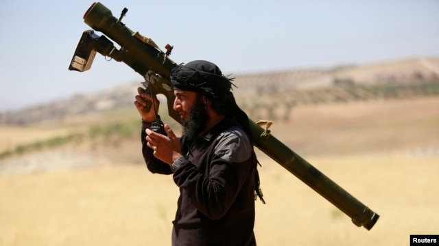 FILE - An Islamist Syrian rebel group Jabhat al-Nusra fighter.