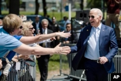 Democratic presidential candidate Joe Biden arrives for a campaign rally at Eakins Oval in Philadelphia, May 18, 2019.