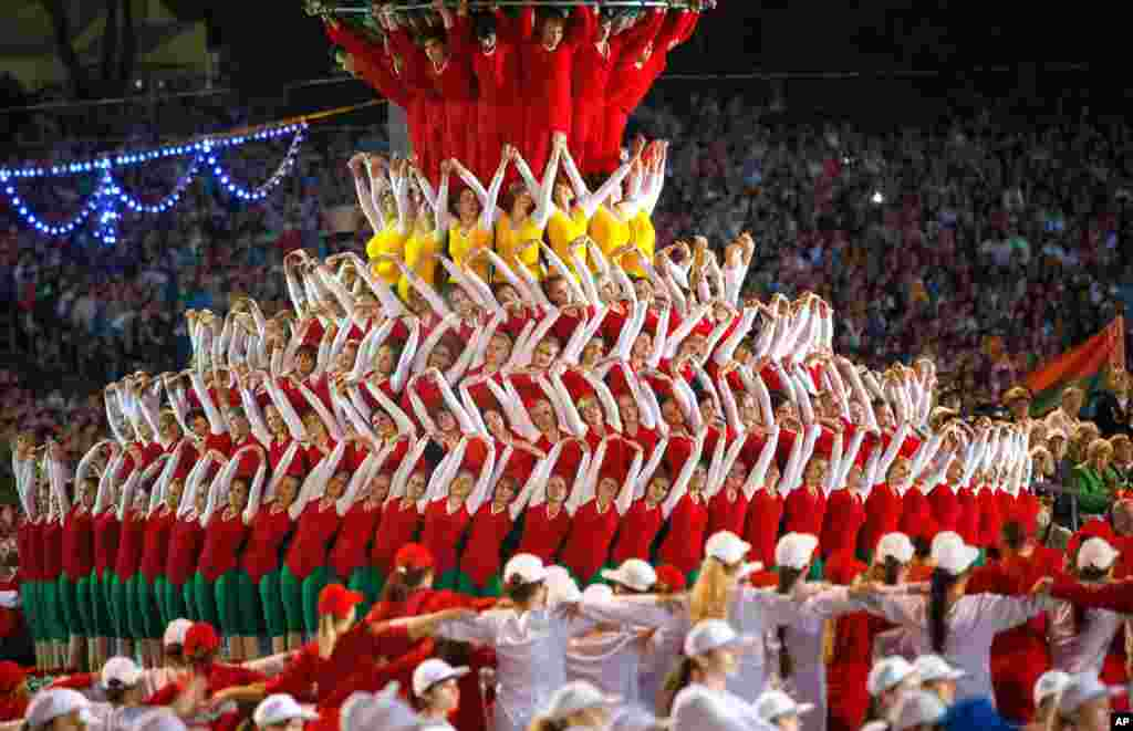 Belarusian sportsmen perform during a parade marking Independence Day in Minsk, Belarus, late July 3, 2014.
