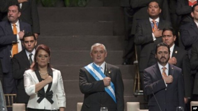 Guatemala's President Otto Perez Molina, center, his Vice President Roxana Baldetti, left, and Congress' President Gudy Rivera listen to their national anthem during Perez's Molina and Baldetti's swearing-in ceremony in Guatemala City, January 14, 2012.