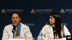 FILE - Dr. Dorry Segev, left and Dr. Christine Durand answer questions about the first ever HIV-positive liver transplant in the world during a news conference at Johns Hopkins hospital, March 30, 2016 in Baltimore.