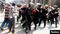 Police detain a supporter of ousted Egyptian President Mohamed Morsi during clashes in central Cairo Aug. 13, 2013.