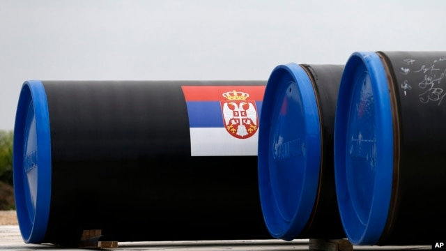 A Serbian flag is seen on a gas pipe on the first section of the Gazprom South Stream natural gas pipeline near the village of Sajkas, 80 kilometers (50 miles) north of Belgrade, Serbia, June 13, 2014.