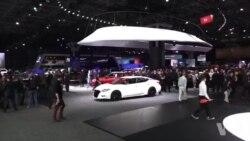 汽车制造商不惧挫折,转向电动和自动驾驶车辆 (英语视频)