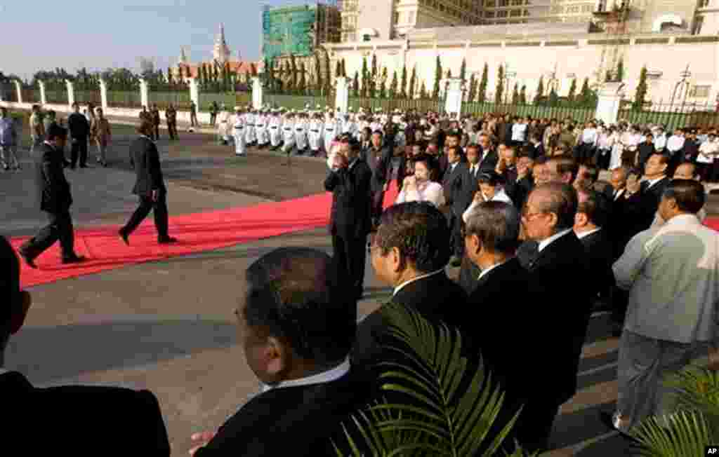 Cambodia's Prime Minister Hun Sen, center, and his wife Bun Rany, right center, weep during a memorial service near the site where festival goers were killed in Monday's stampede in Phnom Penh, Cambodia, Thursday, Nov. 25, 2010. (AP Photo/Heng Sinith)