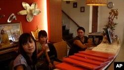 Receptionists at the empty Indara massage shop in Bangkok