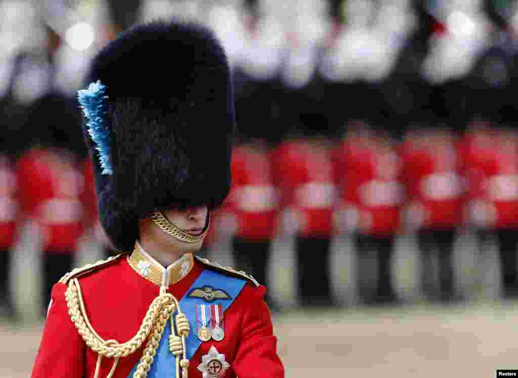 Britain's Prince William attends attends the Trooping the Color ceremony on Horse Guards Parade in central London. Trooping the Color is a ceremony to honor the sovereign's official birthday.