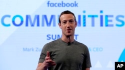FILE - Facebook CEO Mark Zuckerberg speaks in preparation for the Facebook Communities Summit, in Chicago, Illinois, June 21, 2017.