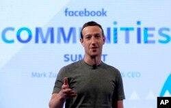 FILE - Facebook CEO Mark Zuckerberg speaks in preparation for the Facebook Communities Summit, in Chicago, Illinois, June 21, 2017.