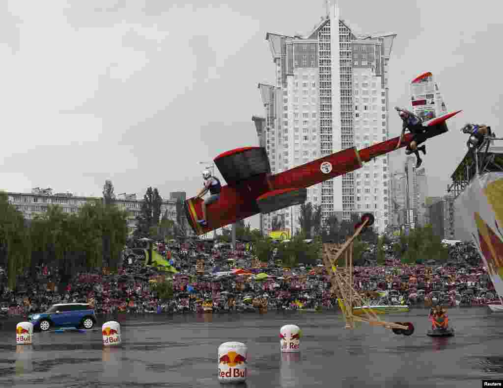 Participants operate a homemade flying machine during the Red Bull Flugtag (Flight Day) event in Kyiv, Ukraine.