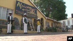 "Reine Osso runs the ""African Queen"" Arts and Crafts store in Johannesburg, South Africa"