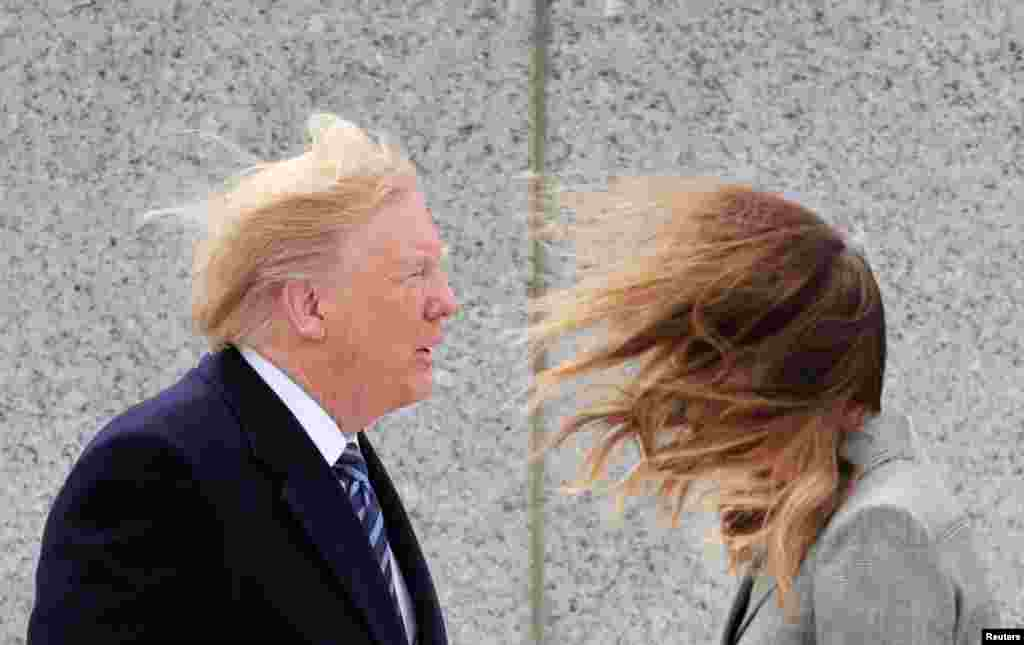 U.S. President Donald Trump and first lady Melania Trump are seen in strong winds during a Victory in Europe Day 75th anniversary ceremony at the World War II Memorial in Washington.