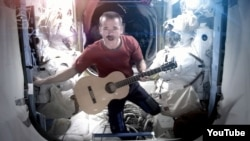 Canadian astronaut Chris Hadfield sings aboard the International Space Station, May 12, 2013.
