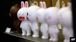 FILE - Figures of Cony the bunny, one of Line's characters, are displayed at the Line Friends flagship shop in Seoul, South Korea.