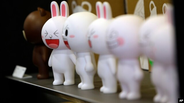 FILE - Figures of Cony the bunny, one of Line's characters, are displayed at the Line Friends flagship shop  in Seoul, South Korea. Line, founded five years ago, already has a billion global registered users.