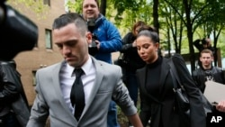 FILE - Singer Tulisa Contostavlos leaves Southwark Crown Court, central London, April 22, 2014.