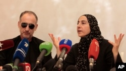 Mother of the Boston bombing suspects, Zubeidat Tsarnaeva, with the suspects' father, Anzor Tsarnaev, addressing news conference in Makhachkala, southern Russian province of Dagestan, April 25, 2013.