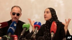 The mother of the two Boston bombing suspects, Zubeidat Tsarnaeva, with the suspects' father Anzor Tsarnaev, left, speaks at a news conference in Makhachkala, the southern Russian province of Dagestan, April 25, 2013.
