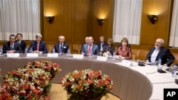 From left, Chinese Foreign Minister Wang Yi, U.S. Secretary of State John Kerry, French Foreign Minister Laurent Fabius, Russia's Foreign Minister Sergei Lavrov, EU foreign policy chief Catherine Ashton and Iranian Foreign Minister Mohammad Javad Zarif, g