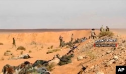 Pro-government troops taking up positions on the Iraq-Syria border in this frame grab from video provided Nov. 8, 2017, by the government-controlled Syrian Central Military Media.
