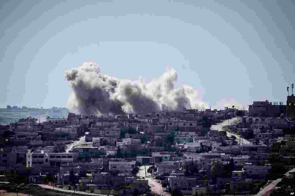 Smoke rises from buildings after an airstrike hit in Habit village, Hama, Syria, Sep. 25, 2013.