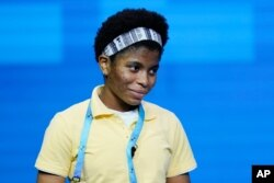 Zaila Avant-garde, 14, from Harvey, Louisiana, reacts after correctly spelling a word during the finals of the 2021 Scripps National Spelling Bee at Disney World, July 8, 2021, in Lake Buena Vista, Fla.