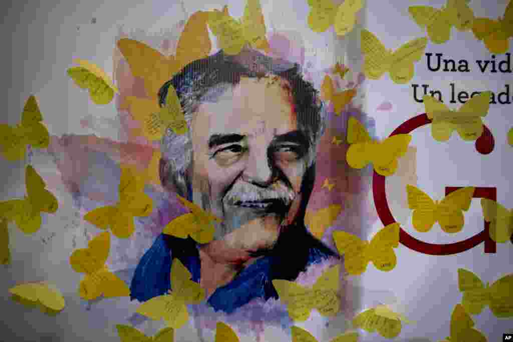"A placard of Nobel Prize-winning novelist Gabriel Garcia Marquez is surrounded by yellow butterfly cutouts with messages, placed there by fans, at a bookstore in Mexico City. Marquez fans are commemorating the first anniversary of his death. In 'Gabo's renowned novel ""100 Years of Solitude,"" clouds of yellow butterflies precede a forbidden lover's arrival."