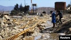 Jalur kereta api yang rusak akibat banjir di Diego de Almagro, Chile, Maret 2015.