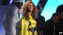 Beyonce accepts the award for best female R& B at the BET Awards on July 1, 2012, in Los Angeles.