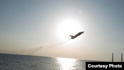 Image of Russian fly-over near guided-missile destroyer USS Donald Cook in Baltic Sea as provided by the U.S. Navy 6th Fleet.