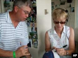 White Sox organist Nancy Faust autographs a baseball cap for a fan.